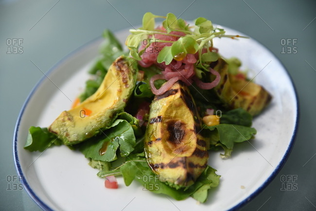 Grilled avocado salad with microgreens