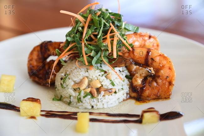 Glazed shrimp surrounding a pile of rice