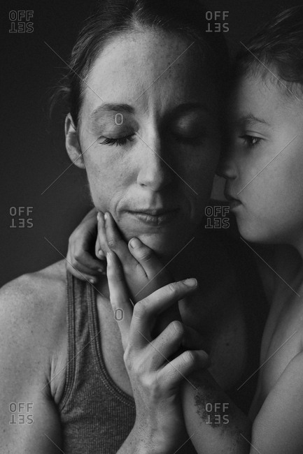 Boy holding mother's face