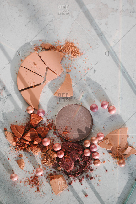 Make up still life with crumbling pink blush