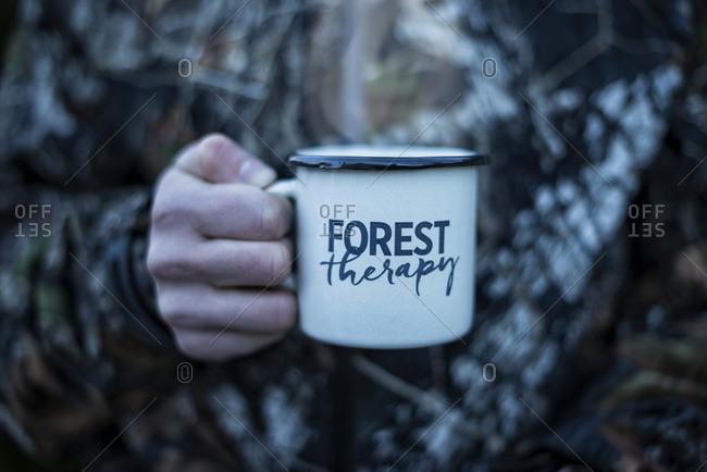 Hunter holding mug