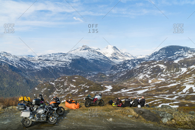 Bikers relaxing in mountains - Offset