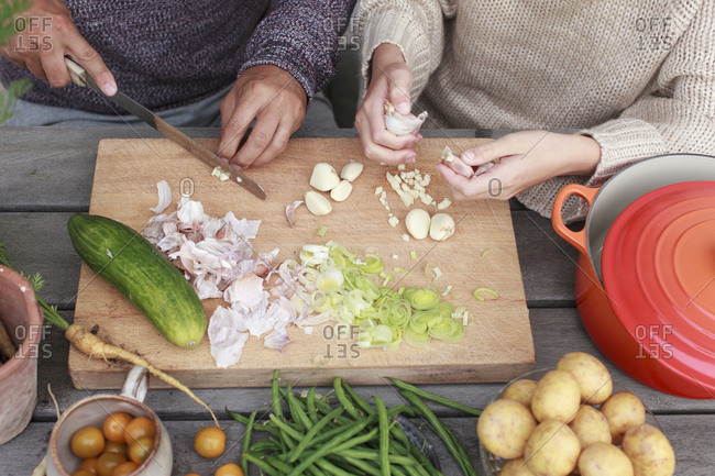 father and daughter chopping vegetables