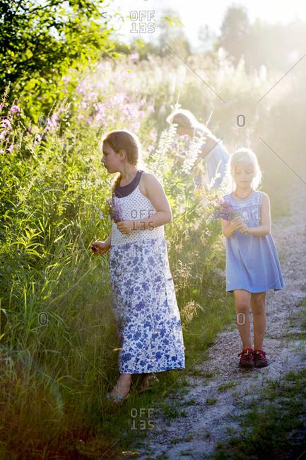 Girls picking flowers in garden