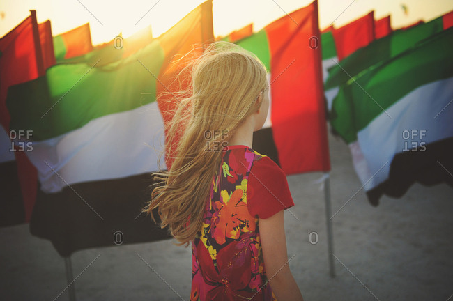 Young girl attending National Flag Day event at sunset