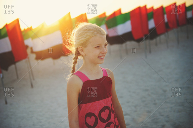 Young girl with United Arab Emirates flags on Kite Beach, Dubai