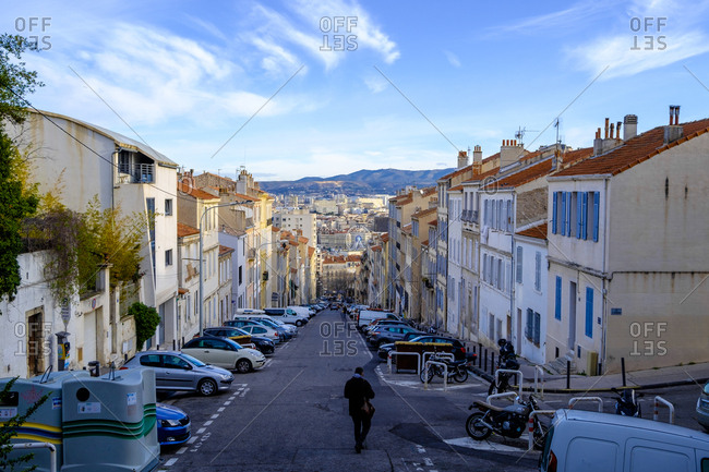 Marseille, France - March 6, 2017: Man walks on hilly street