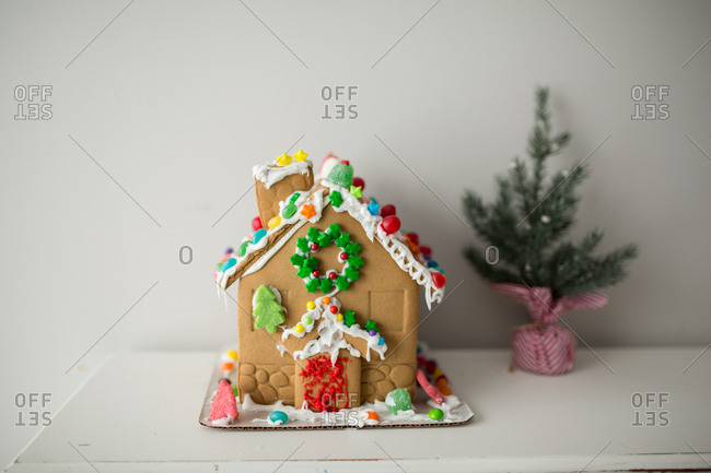 Gingerbread house left on a white table
