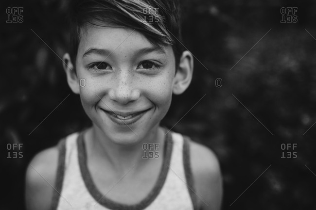 Boy smiling wearing tank top