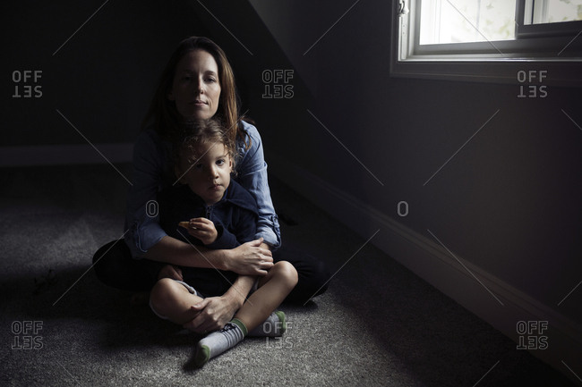 Mother and child sitting near a window