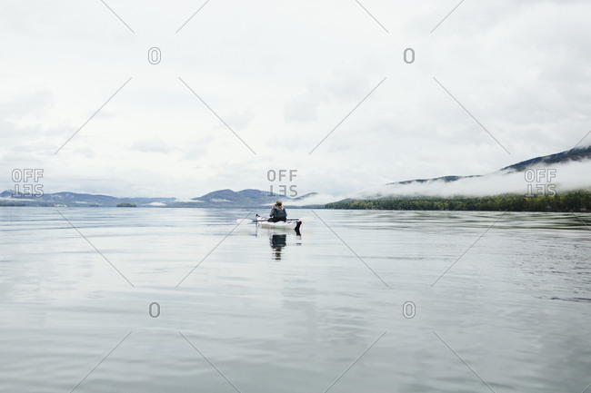 Woman kayaking and camping in Lake George, New York