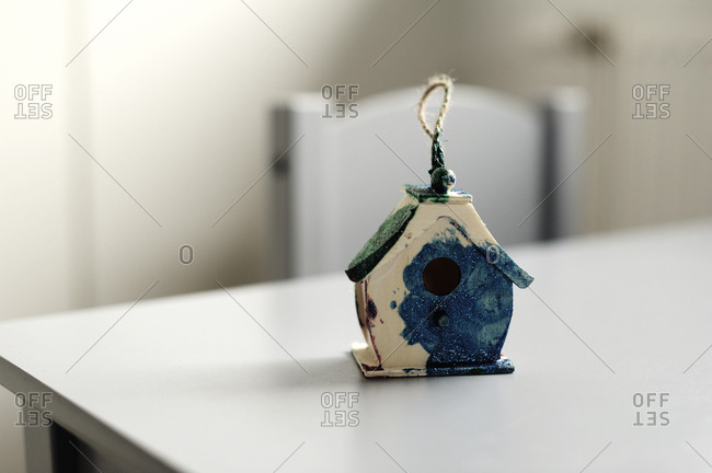 Small bird house painted by a child