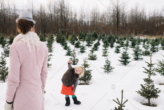 Mother and child have fun at a Christmas tree farm