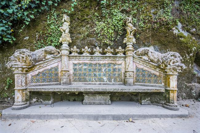July 26, 2016: Portugal, Sintra . Quinta da Regaleira also known as Palacio (palace) da Regaleira or Palacio do Monteiro dos Milhoes, a bench