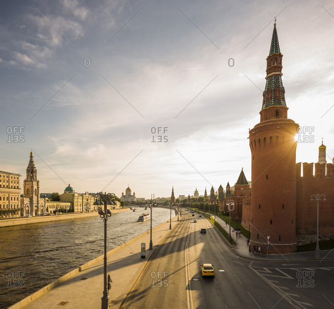 July 27, 2017: Russia, Moscow . Sunset view of the Moskva River (Moscow River), on the left the Moscow Kremlin south wall with the Beklemishevskaya (Moskvoretskaya) Tower (one of the corner towers of the Moscow Kremlin Wall)