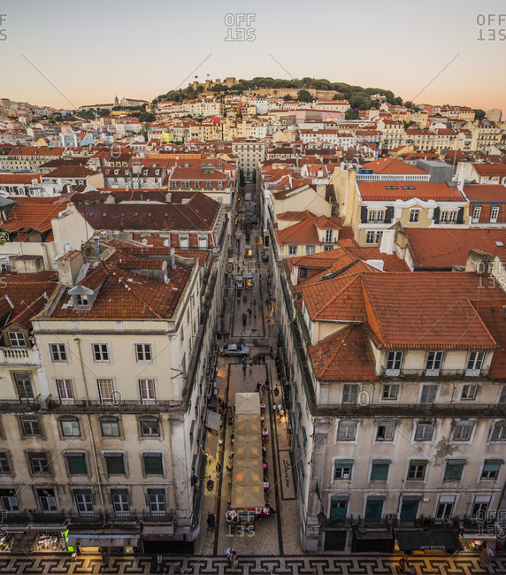 July 21, 2016: Portugal, Lisbon . Sunset view of The Baixa district and the Castelo de Sao Jorge, the medieval Castle of St. George is a moorish castle overlooking the town