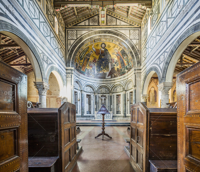 September 23, 2017: Italy, Tuscany, Florence . Basilica di San Miniato al Monte, view of the apse with the mosaic of Christ the Pantocrator between the Madonna (Virgin Mary) and San Miniato (Saint Miniato or Minias), the mosaic was made in 1260