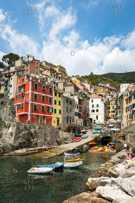 Liguria, Italy, Europe - May 25, 2017: The colorful buildings and boats in Riomaggiore harbour, Cinque Terre, UNESCO World Heritage Site