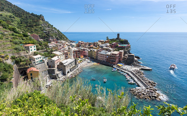 Liguria, Italy, Europe - May 23, 2017: A scenic lookout over the harbour and old town of Vernazza, Cinque Terre, UNESCO World Heritage Site