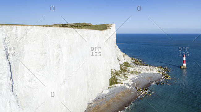 White chalk cliffs of Beachy Head and lighthouse, South Downs National Park, near Eastbourne, East Sussex, England, United Kingdom, Europe