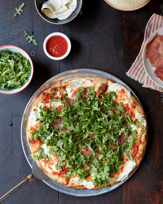 Arugula Pizza with prosciutto from overhead