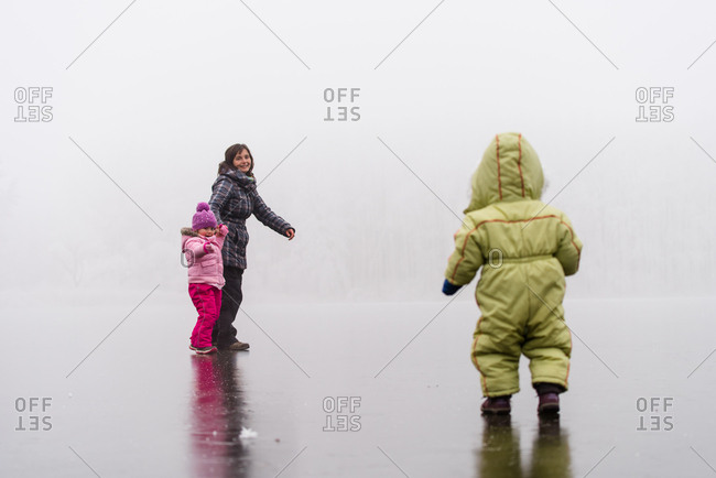 Mother enjoying outdoors with her kids - Winter season