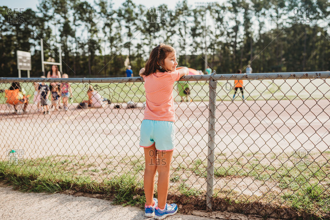 Girl looking over shoulder watching sports practice