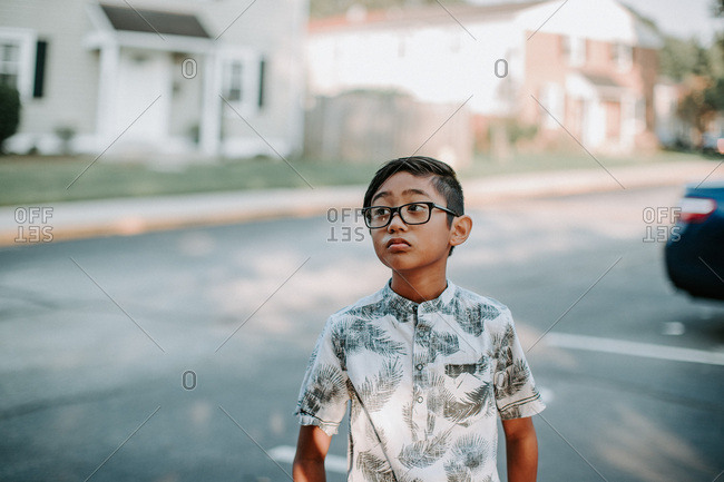 Portrait of a boy wearing glasses looking to the side