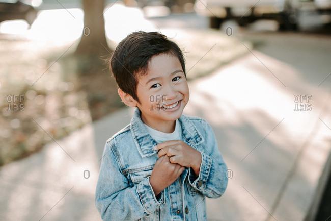 Portrait of a smiling boy wearing a denim jacket