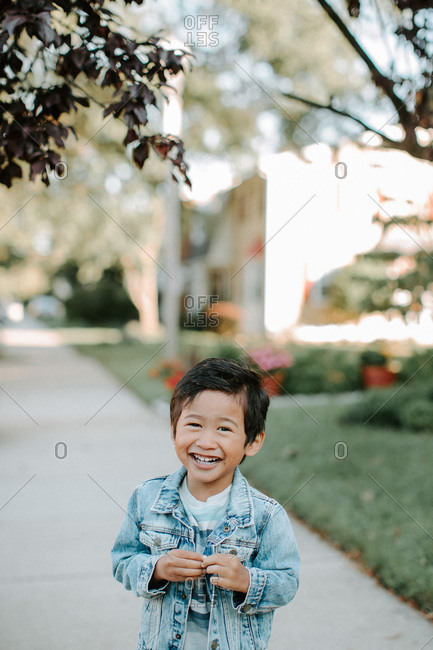 Smiling boy standing outside