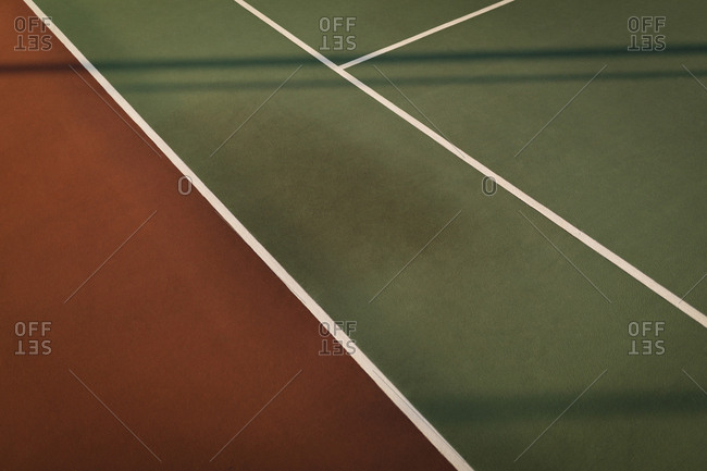 Marking on tennis court on a sunny day