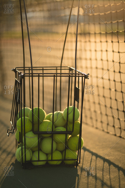 Close-up of tennis balls in container