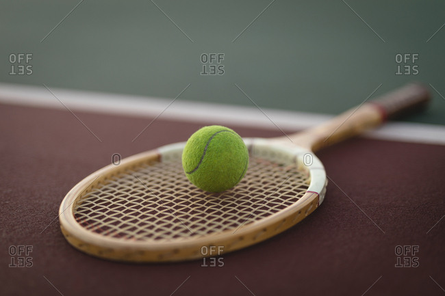 Close-up of tennis balls and rackets in ground