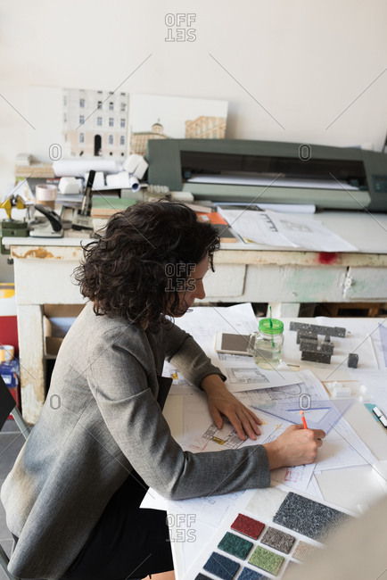 Beautiful female architect working in the office