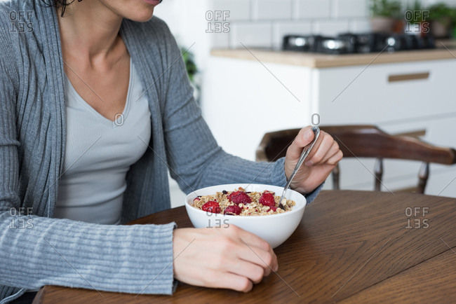 Mid-section of woman having breakfast