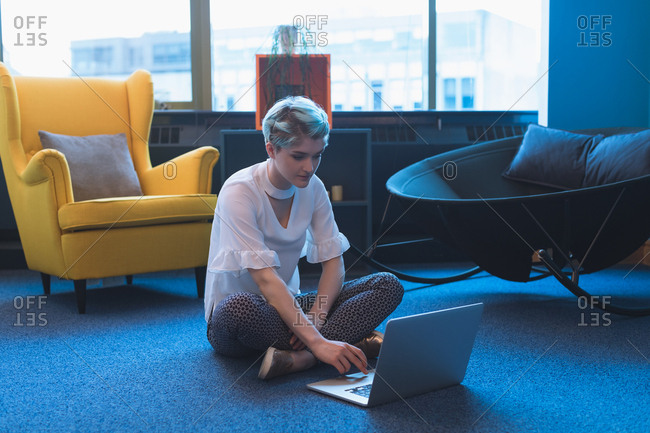 Female executive using laptop in office