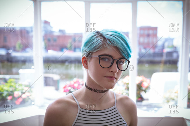 Stylish woman in spectacle posing at home