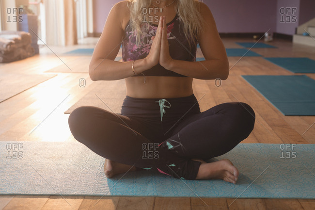 Woman doing meditation exercise in yoga class
