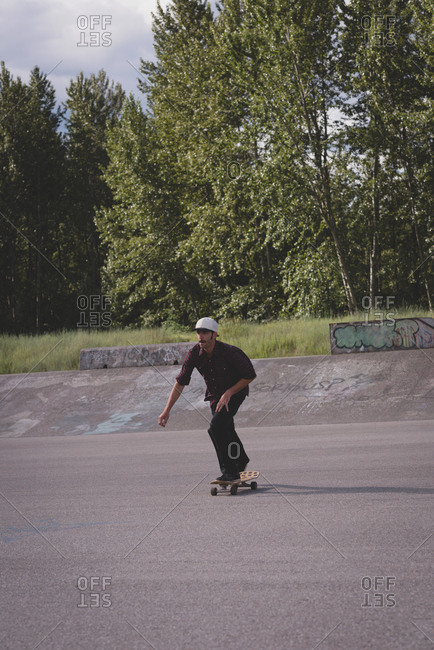 Man skating on skateboard in skate park on a sunny day
