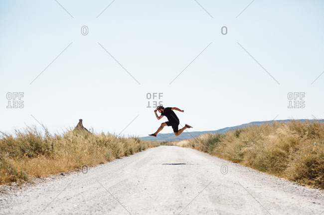 Man jumping on road