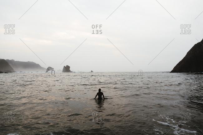 Man bathing on the beach