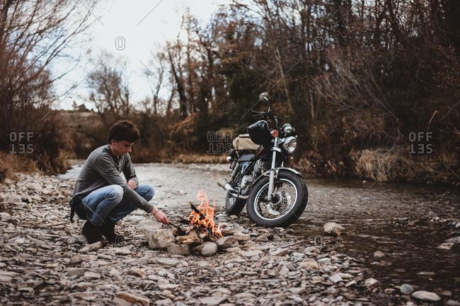 Traveler keeping camp fire