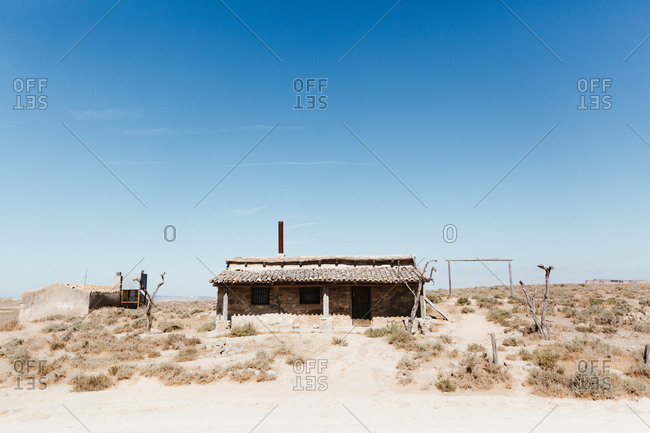 Landscape abandoned house in the desert