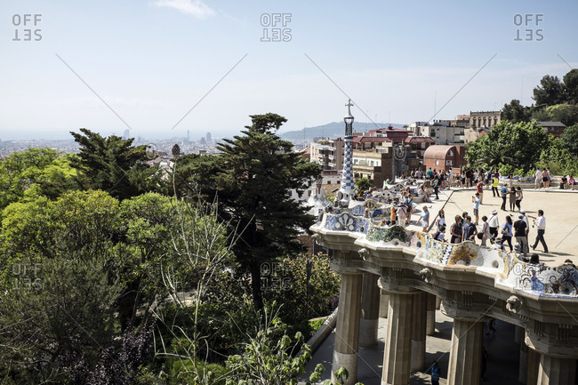 Barcelona, Spain - May 27, 2015: The Park Guell is an Antoni Gaudi-designed public park system composed of gardens and architectonic elements located on Monte Carmelo in Barcelona. Here the terrace overlooking the park