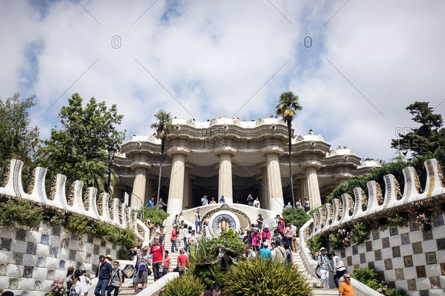 Barcelona, Spain - May 27, 2015: The Park Guell is an Antoni Gaudi-designed public park system composed of gardens and architectonic elements located on Monte Carmelo in Barcelona. Here the fountain at the entrance with the dragon