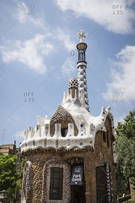 Barcelona, Spain - May 27, 2015: The Park Guell is an Antoni Gaudi-designed public park system composed of gardens and architectonic elements located on Monte Carmelo in Barcelona. Here the pavilion and the tower at the entrance