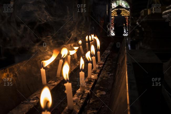 Monywa, Myanmar - 24 September 2016: Burning candles inside Thanboddhay Paya main temple