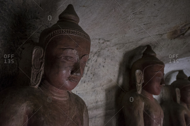 Buddha statue inside a cave at Hpo Win Daung