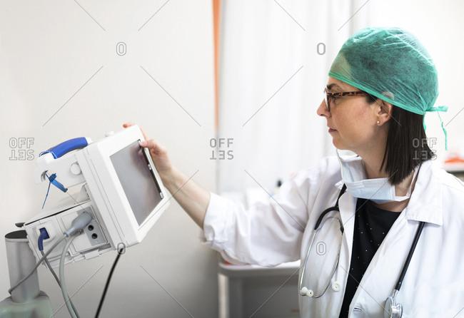 Doctor adjusting medical device
