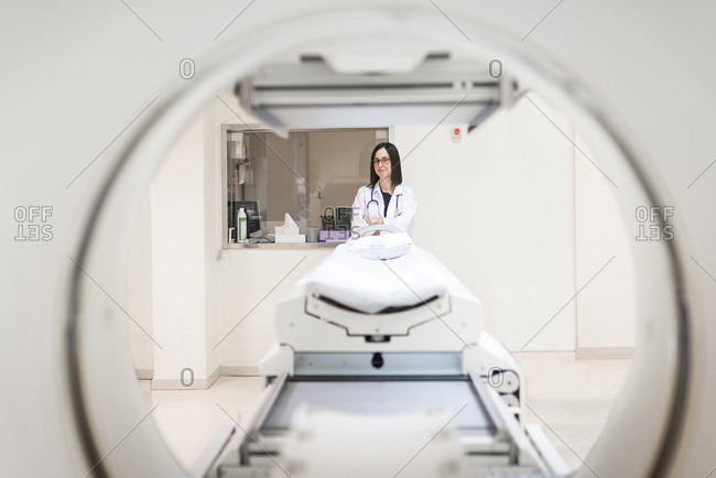 Doctor at MRI scanner